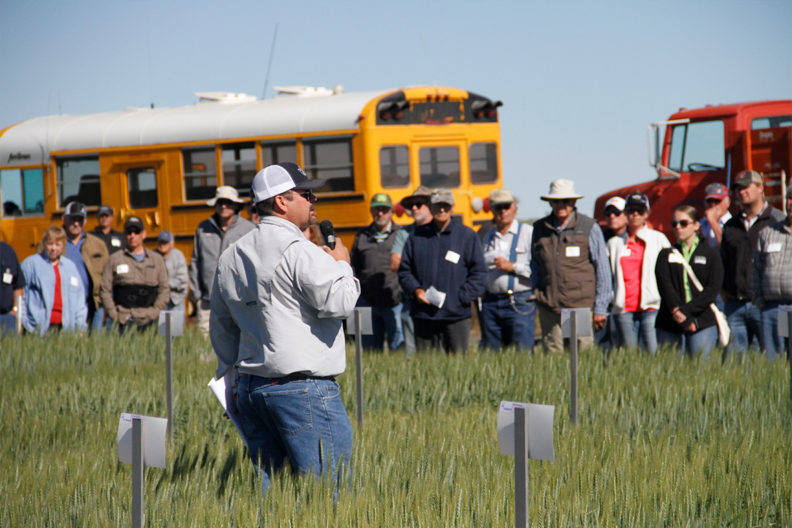 A man speaking to participants at the 2018 Lind Field Day.