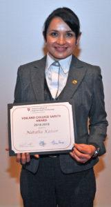 Natalia Kaiser holding award.