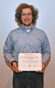 Patrick Robinchaud holding award.