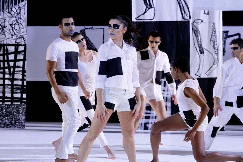 """Dancers pose in a provocative scene from the performance """"Tesseract˚."""""""