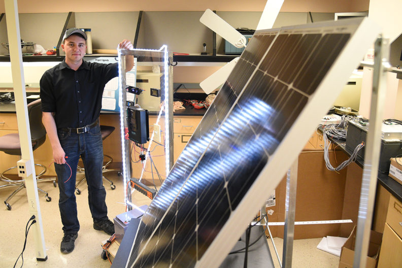 Arthur Baranovskiy working in a laboratory at WSU Tri-Cities.