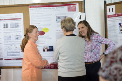 Jaclyn Thatcher, right, talks about her project on group medical visits for patients with chronic pain.