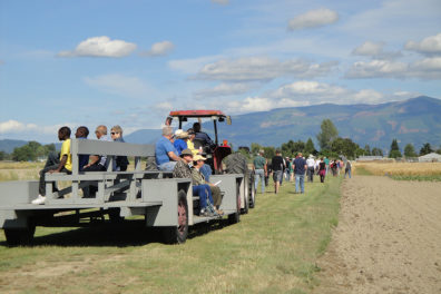 A group of people take a tractor ride in Mount Vernon.