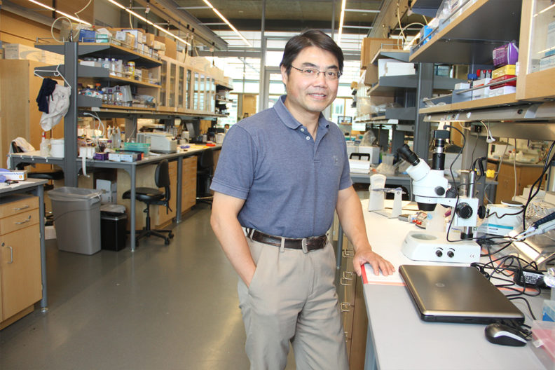 Min Du in his laboratory