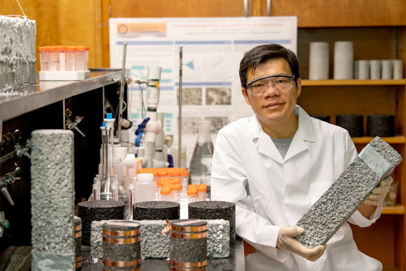 Xianming Shi in lab with pavement samples.