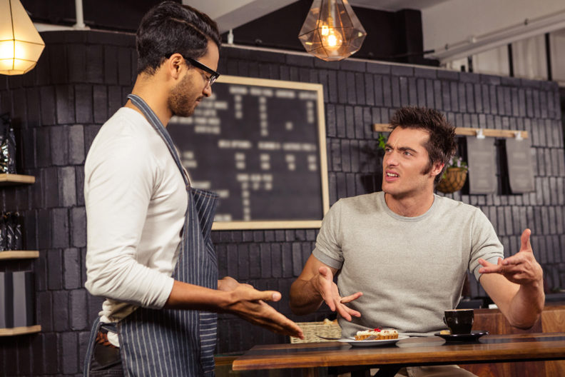 Customer and waiter arguing with one another.