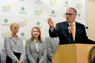 Gov. Inslee speaking at the Fred Hutchinson Cancer Research Center.