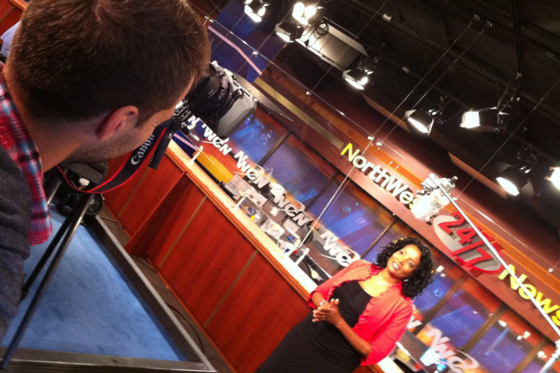 Shaniqua Manning standing in front of a camera on the Northwest Cable News set.