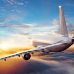 A passenger jet flying through the sky.