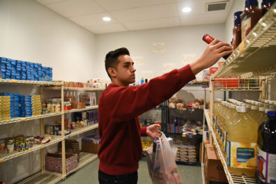 Student looking for food at a food pantry.