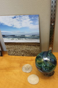 Glass float and sand dollars