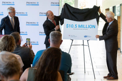 Premera reveals sign announcing $10.5 million gift to support rural health care.