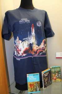 Science fiction books and Johnson Space Center T-shirt