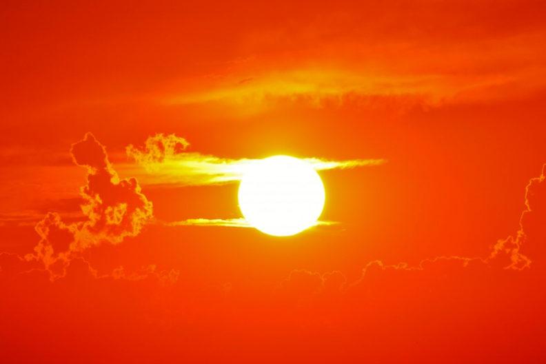 A hot sun fills the orange sky.