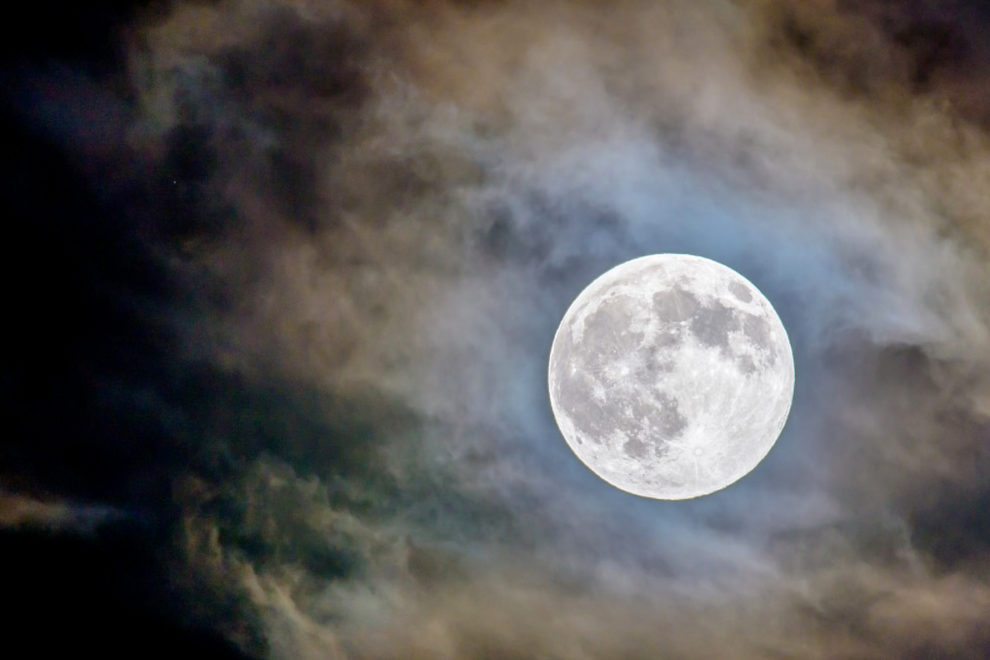 The moon glowing in the night sky.
