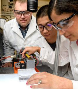 Researchers testing a waterjet-based steerable needle.