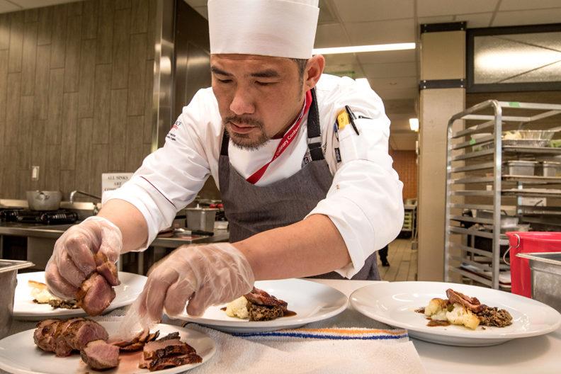 Chef Ray Soendjaya plates entrées at the ACF competition.