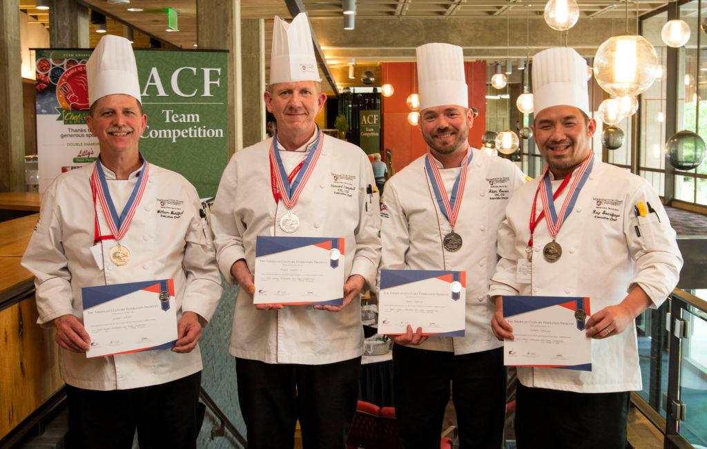 Four WSU chefs holding culinary awards.
