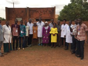 WSU College of Nursing graduates Abel Saba and David Oni with the rest of their volunteer team who are from Burkina Faso, Nigeria and Ivory Coast.