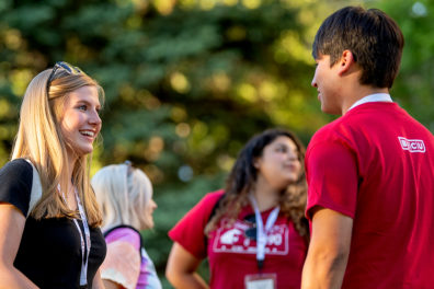 Students talking to one another on campus.