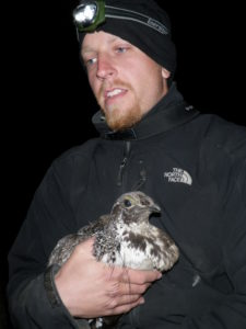 Kyle Ebenhoch holding a sage-grouse.