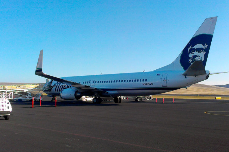 Alaska Airlines plane parked on Tarmac at Pullman-Moscow Regional Airport.