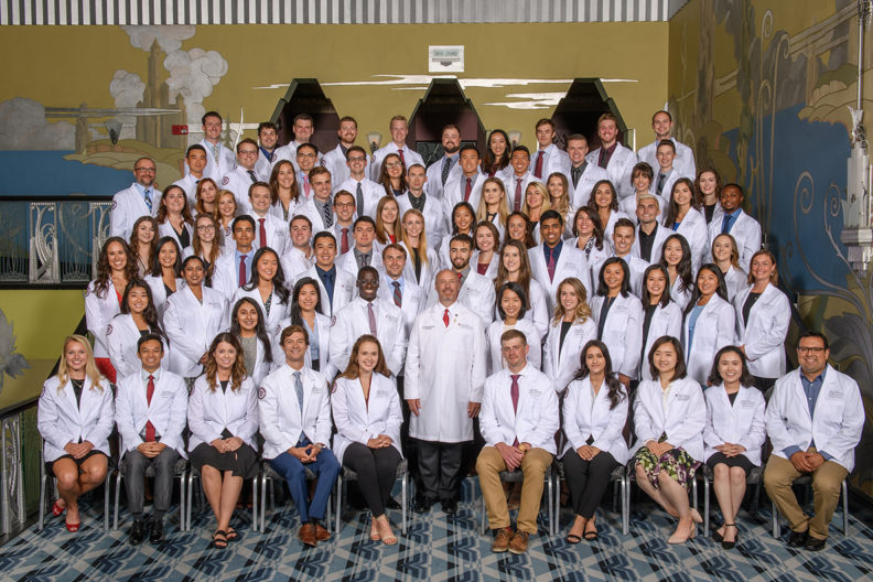 Medical school students posing for a group photo.