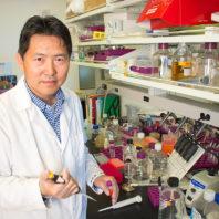 Closeup of Zhenjia Wang in a laboratory.