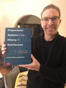 Closeup of Matthew Cohen with his new book.