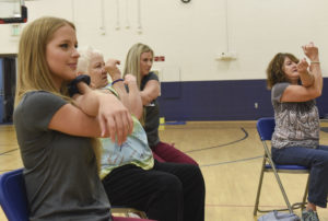 Students lead a stretching class.