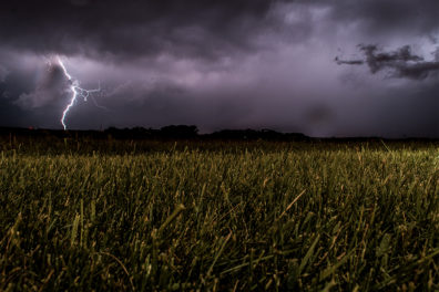 Lightning over an agricultural field.
