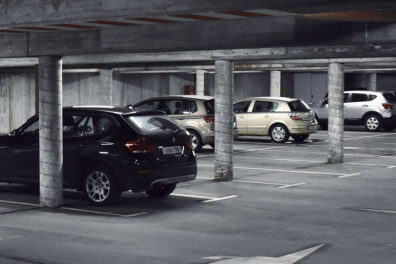 Cars parked in a parking garage.
