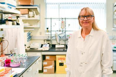 Birgitte Ahring standing in laboratory.