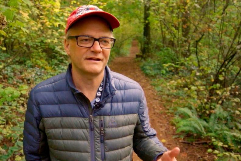Closeup of Brian Brandt in forest.