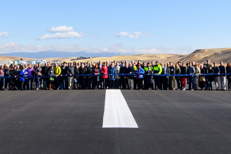 People gather on the PUW runway to celebrate its reopening.