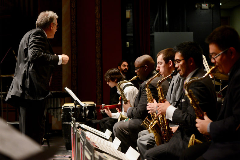 A conductor leads a jazz band.