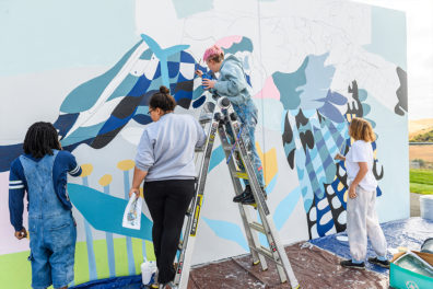 Students working on a mural
