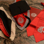 A photograph of WSU regalia scattered on a table