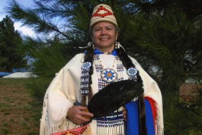 Closeup of Robbie Paul in traditional Native American dress.