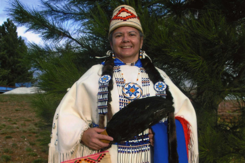 Closeup of Robbie Paul in traditional Native American dress.