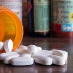 Closeup of pills and pill bottles.