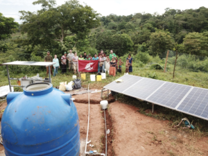 The WSU student chapter of Engineers Without Borders stands behind a solar-powered water pump in Panama.