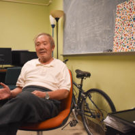 Closeup of KC Wang in his office.