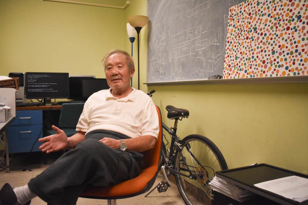 Closeup of KC Wang in his office.