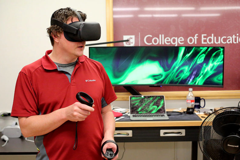 Don McMahon wearing a virtual reality headset.