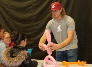 Radd Thomas finishes making a balloon unicorn.