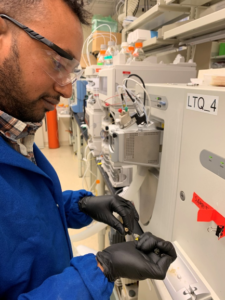 Elias Zegeye uses an LTQ Mass Spectrometer at a PNNL laboratory.