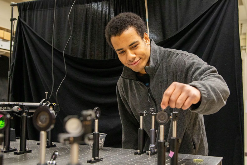 WSU junior Jamil Fields works in a laboratory.