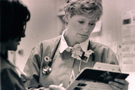 Closeup of Margaret Bruya holding a clipboard.