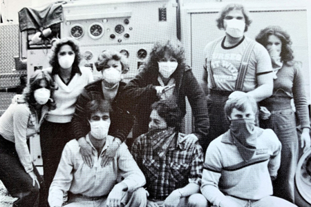 People wearing masks following the eruption of Mount St. Helens.